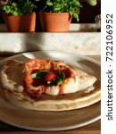 a calzone pizza on a white... | Shutterstock . vector #722106952