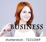 "Red-haired businesswoman show abstract word ""businiess'. - stock photo"