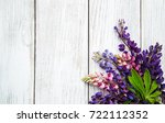 lupine flowers on a old wooden... | Shutterstock . vector #722112352