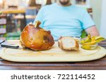 man eating knuckle of pork and... | Shutterstock . vector #722114452