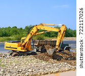 Small photo of Extracting and loading gravel excavated in the mainstream of the river