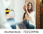 happy young woman with... | Shutterstock . vector #722124946