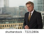 Portrait of a senior executive by a window  looking off camera - stock photo
