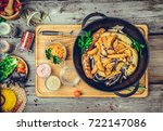fried sausages with baked... | Shutterstock . vector #722147086