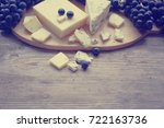 cheese on the wooden board  | Shutterstock . vector #722163736