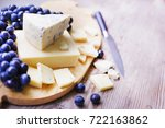 cheese on the wooden board  | Shutterstock . vector #722163862