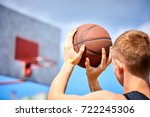 male playing basketball outdoor | Shutterstock . vector #722245306