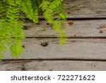 a wooden board background with... | Shutterstock . vector #722271622