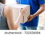 woman accepting a delivery...   Shutterstock . vector #722326006