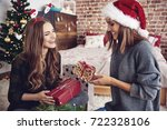 friends presenting gifts each... | Shutterstock . vector #722328106