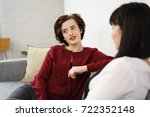 two young lady friends having a ... | Shutterstock . vector #722352148