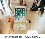Small photo of PARIS, FRANCE - SEP 22, 2017: New iPhone 8 and iPhone 8 Plus, as well the updated Apple Watch, Apple TV goes on sale today in Apple Store with man hand holding phone looking at the phone apps
