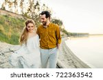 a young couple is having fun... | Shutterstock . vector #722363542