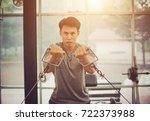 handsome bodybuilder works out... | Shutterstock . vector #722373988