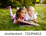 two young girls lying on the... | Shutterstock . vector #722396812