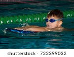 boy child swimming in pool... | Shutterstock . vector #722399032