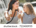 young pretty mother and her... | Shutterstock . vector #722400955