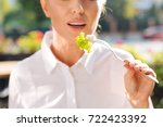 close up of woman holding a... | Shutterstock . vector #722423392