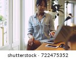 young business woman is working ... | Shutterstock . vector #722475352