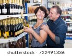 smiling mature husband and wife ... | Shutterstock . vector #722491336