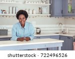 smiling young african woman... | Shutterstock . vector #722496526