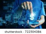 businessman holding money | Shutterstock . vector #722504386
