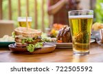 sandwich   glass of beer   Shutterstock . vector #722505592