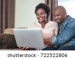 smiling african couple browsing ...   Shutterstock . vector #722522806