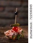 tapas on crusty bread  ... | Shutterstock . vector #722530345