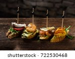 tapas on crusty bread  ... | Shutterstock . vector #722530468
