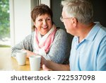 senior couple in love sitting... | Shutterstock . vector #722537098