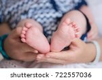 mother holds newborn baby's... | Shutterstock . vector #722557036
