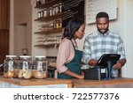 two young african entrepreneurs ... | Shutterstock . vector #722577376