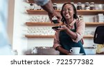 smiling barista using nfs... | Shutterstock . vector #722577382