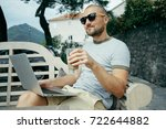 man in sunglasses works on a... | Shutterstock . vector #722644882