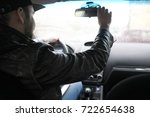 the man behind the wheel of a... | Shutterstock . vector #722654638