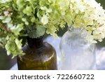 flowers of hydrangea in glass... | Shutterstock . vector #722660722