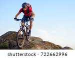 cyclist in red t shirt riding... | Shutterstock . vector #722662996