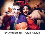 a guy in a joker costume and a... | Shutterstock . vector #722673226