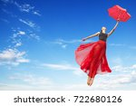 Young Elegant Woman Flying In...