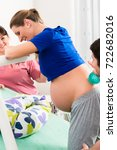 woman laboring in delivery room ... | Shutterstock . vector #722682016