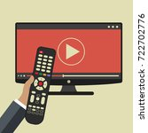 hand holding remote control. tv ... | Shutterstock .eps vector #722702776