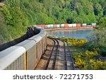 The freight train moving along the coastline - stock photo