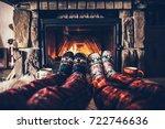 feet in woollen socks by the... | Shutterstock . vector #722746636