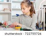 schoolgirl  repairing the...   Shutterstock . vector #722755726