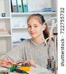 schoolgirl  repairing the... | Shutterstock . vector #722755732