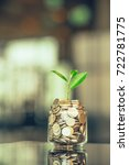 plant growing out of coins with ... | Shutterstock . vector #722781775