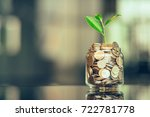 plant growing out of coins with ... | Shutterstock . vector #722781778