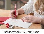 Young Woman Writing Christmas...