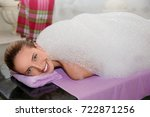young woman covered with foam... | Shutterstock . vector #722871256